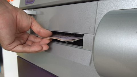 ATM Dispensing Thai Baht Money in Cash