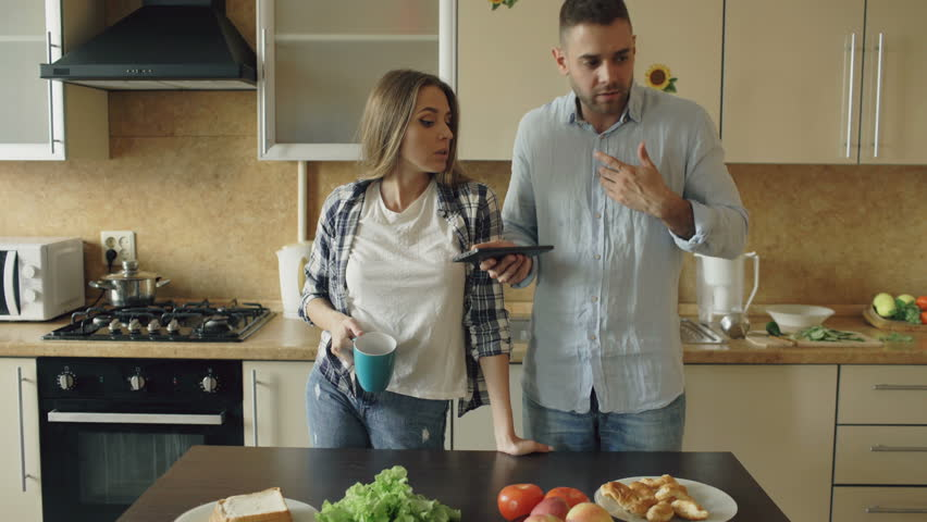 Young Couple Quarrels In The Kitchen At Home   4K Stock Footage Clip