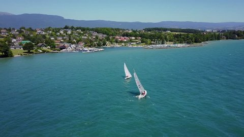 Aerial view of a Sailing Race on Lake Geneva , Switzerland. Yacht from drone. landscape with wake of Sailboat.
