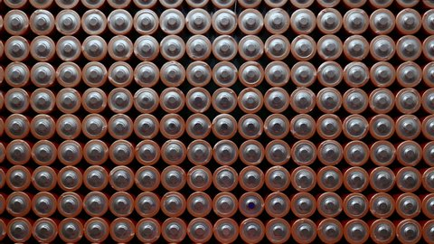Energy abstract Background of Batteries. The top view of the Rows of AA Batteries. Used Alkaline Batteries