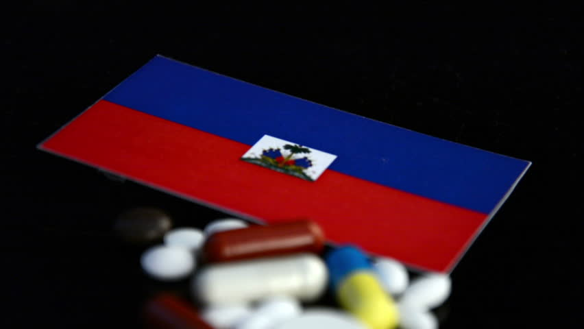 Jakarta indonesia february 20 2018 macro shot of a world map haitian flag with lot of medical pills isolated on black background hd stock footage clip gumiabroncs Gallery
