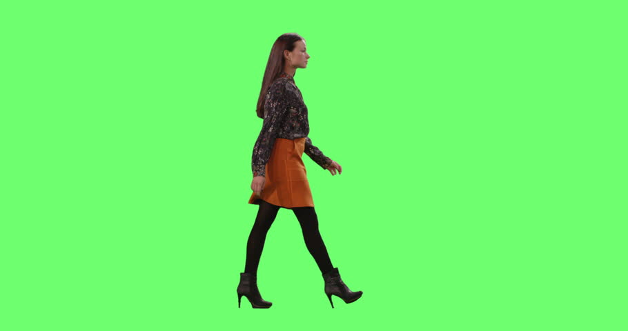 Stylish Young Brunette Gracefully Walking. Shot on a Mock-up Green Screen in the Background. Shot on RED Cinema Camera in 4K (UHD). | Shutterstock HD Video #28531693