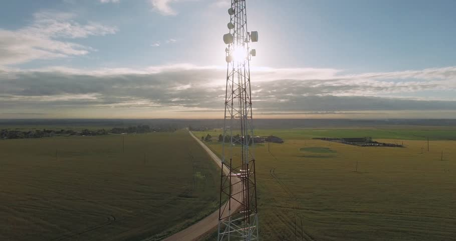 Aerial view of tower mobile station in sunlight, gsm, view from height.    Shutterstock HD Video #28536952