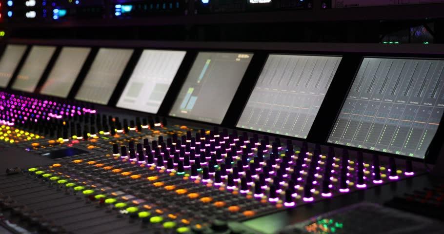Professional audio mixer. A small depth of field flickering light bulbs.Hands of & Professional Audio Mixer. A Small Depth Of Field Flickering Light ... azcodes.com