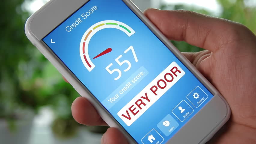 Checking credit score on smartphone using application. The result is VERY POOR
