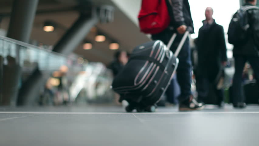 Passengers with luggage at a modern Station in 1080p HD with bokeh #2856742