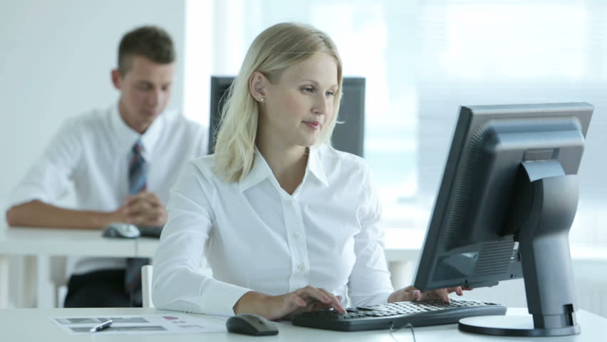 Female office clerk with positive attitude spending a usual working day in office | Shutterstock HD Video #2862532