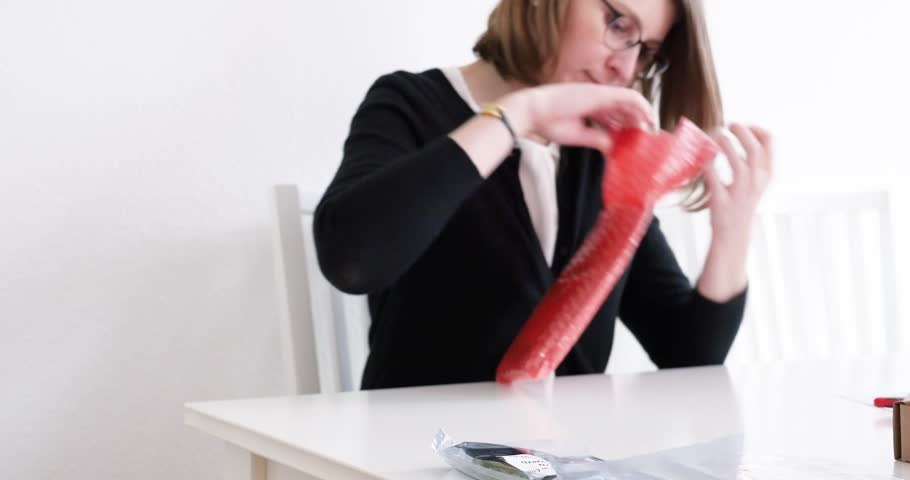 PARIS, FRANCE - CIRCA 2017: Woman unboxing parcel containing Dell computer hardware part for her workstation - computer part replacement Nvidia Quadro professional video card