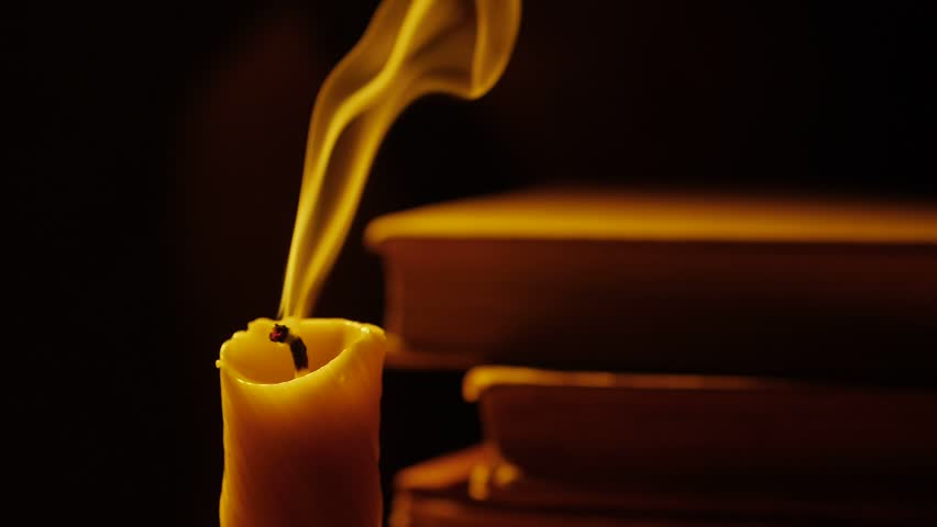 Image result for blown out candle and a book