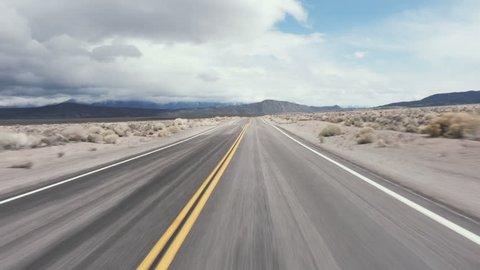 Driving USA: The open road – spectacular roller coaster road through the desert, California, USA