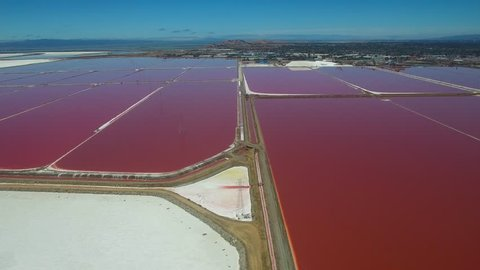 Fremont, California-2010s: Aerial footage over the remarkable red and white salt flats in the Fremont, California bay area.