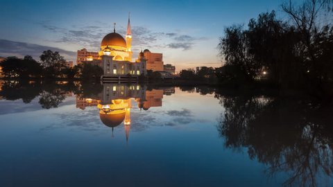 Beautiful sunrise timelapse at the Royal Mosque in Klang, Selangor, Malaysia. 4K UHD. Pan Up Motion Time-lapse.