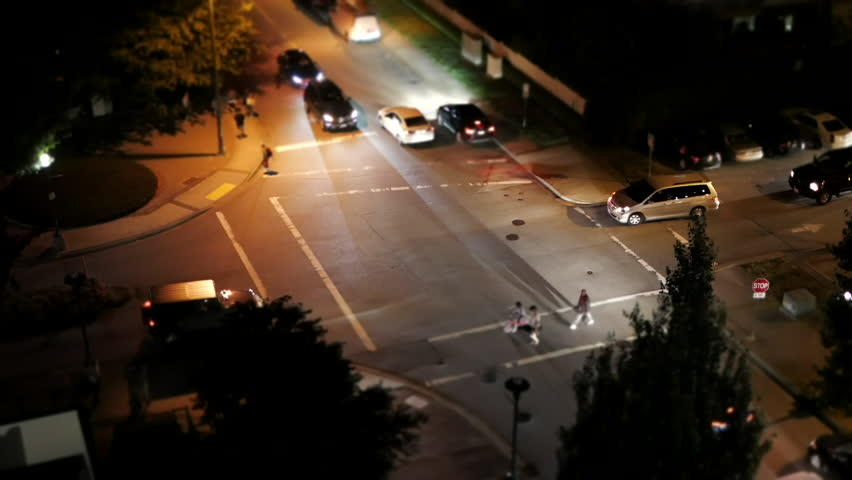 Coquitlam, BC, Canada - July 01, 2017 : Motion of four way traffic intersection traffic flow after celebrating Canada day at night with miniature effect