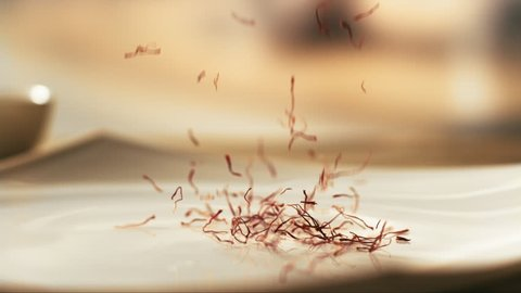 saffron falling in a plate in slow motion