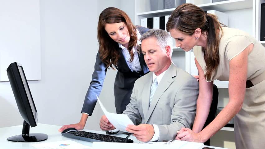 Young Caucasian management team focusing on commodity market in business workplace | Shutterstock HD Video #2873812