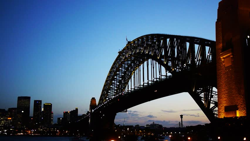 a time lapse of the lights on sydney harbour bridge coming on