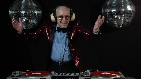 amazing DJ grandpa, older cool man djing and partying in a disco setting. these retired rockers will get the party going