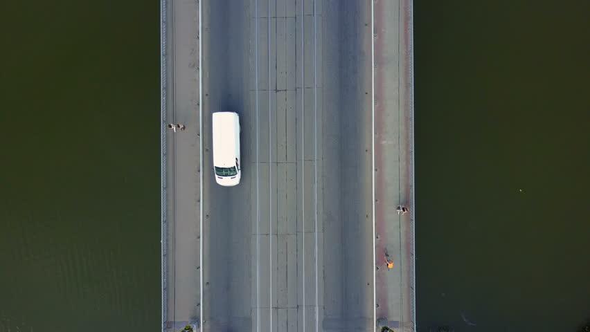 VINNITSA, UKRAINE - JULY 2017: Aerial top view of bridge road automobile traffic of many cars, transportation concept