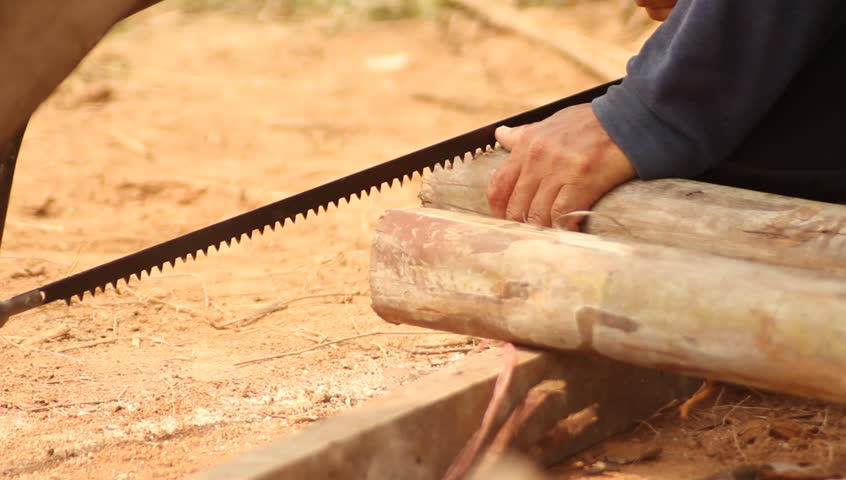 Man Uses Hand Saw And Stock Footage Video 100 Royalty Free