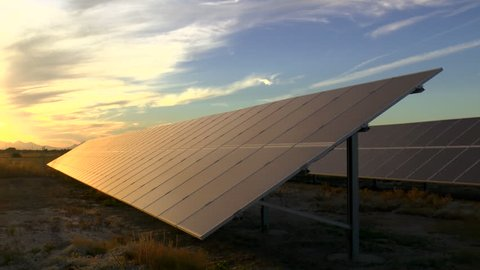 Time Lapse, Rich yellow, orange, red colors light up solar panel at sunset. 1080p