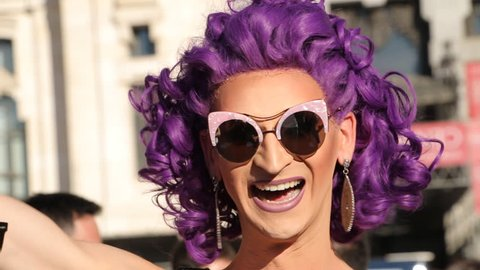 MADRID, SPAIN 01 JULY 2017: Set of portraits of attractive people, World Pride festival in Madrid 2017. International participants in costumes celebrates of LGBT Gay Pride Parade in Madrid 2017