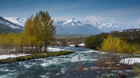 Beautiful spring landscape of Kamchatka Peninsula: view of mountain Paratunka River on a sunny day. Eurasia, Russian Far East, Kamchatka Region.