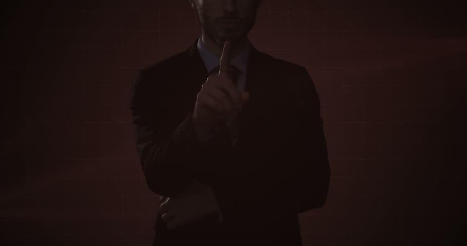 Businessman using digital interface screen against dark background | Shutterstock HD Video #28848502