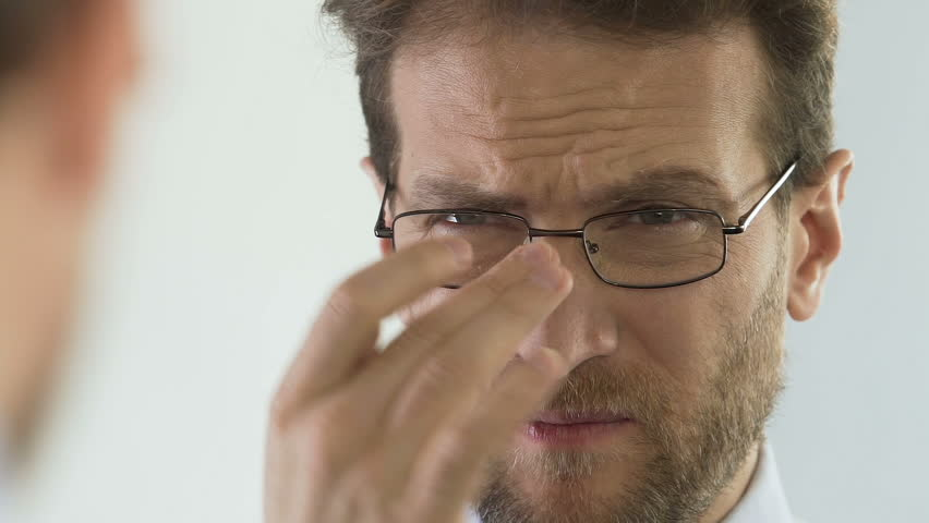 39a9d59575c Male Wearing Eyeglasses and Frowning Stock Footage Video (100 ...