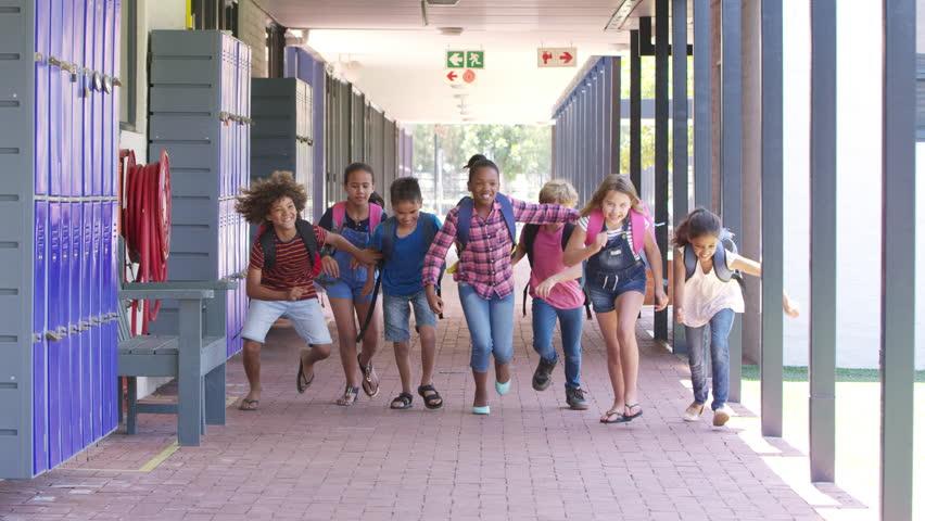 Kids running to camera in school hallway, front view | Shutterstock HD Video #28896502