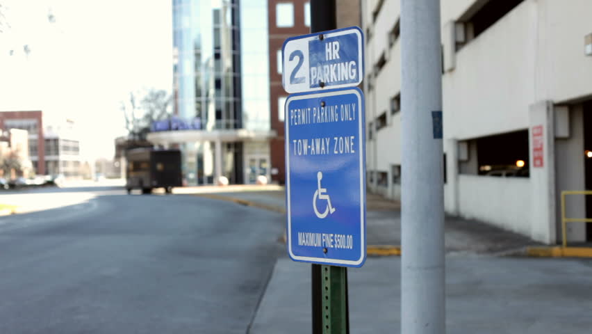 Sign for two hour parking for handicap only.