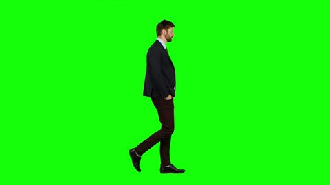Man walks calmly down the street, he is happy. Green screen