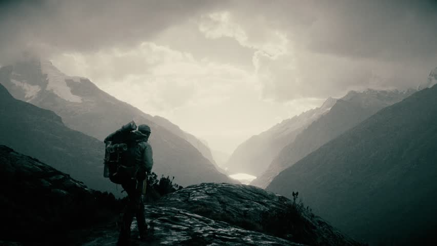Silhouette of a backpacker walking on the peak of a mountain, Santa cruz Trek, Peru. 4k