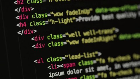 HTML and CSS code developing. Website design code programming on a laptop screen. Web dev work.
