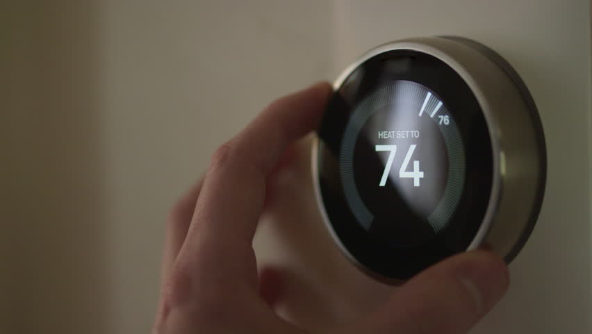 Man Adjusting Smart Thermostat Gadget Settings At Home | Shutterstock HD Video #28941742