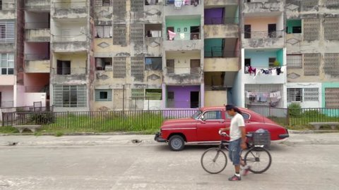 Vintage Cuban car parked outside of old apartment building Cuba. 2015