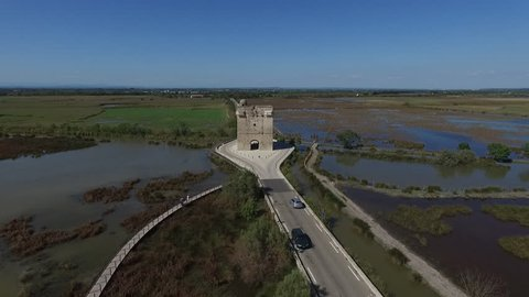 AIGUES MORTES - FRANCE 2016 - DRONE VIEW OF THE CARBONNIERE TOWER. IN THE MIDDLE OF SWAMP. CAMARGUE