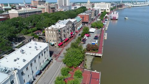SAVANNAH, GA, USA - JULY 1, 2017: Aerial drone footage of Savannah Georgia flyover along the Riverfront district