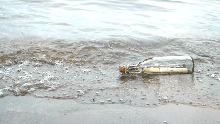 Message in a bottle on the seashore   Shutterstock HD Video #29030092