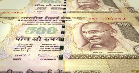 Banknotes of five hundred indian rupees of India rolling, cash money, loop