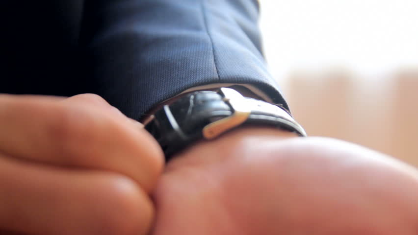 Man looks at his wristwatch. close-up | Shutterstock HD Video #29044102
