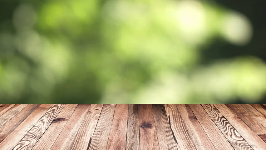 Wood Table Top On Blur Moving Natural Green Leaf