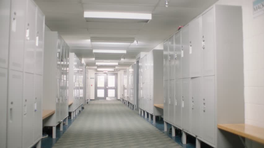 point of view of walking down school university high school hallway past lockers to class lecture in slow motion