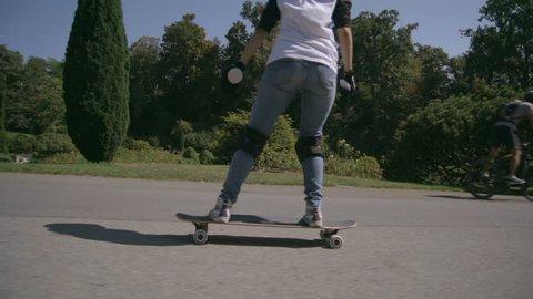 Longboard girl on a skateboard, slowmotion