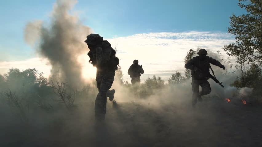 Slowmotion of silhouettes group of military men running on field in smoke and falling killed. Under mortar shelling