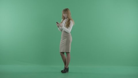 a nice girl is standing with the phone