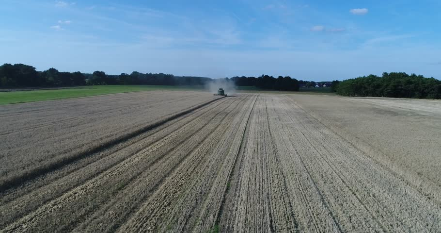 Combine harvester - low pass from front - birds eye view - movie   | Shutterstock HD Video #29179552