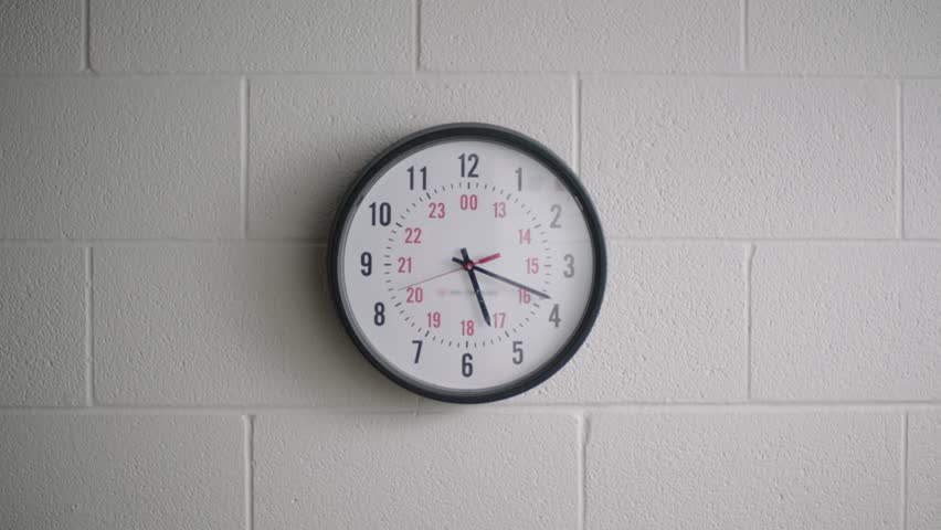 Analog clock in school classroom hallway on wall telling time | Shutterstock HD Video #29222812