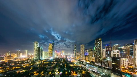 Makati, Philippines - November 14, 2016: Makati Timelapse view showing view over city skyline and Bel Air village in the foreground