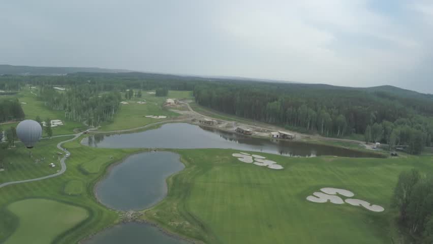 Top view green golf course outdoor green grass field. Aerial view from flying drone