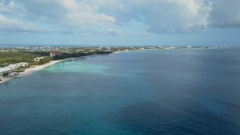 Drone footage of Seven Mile Beach, Grand Cayman, Caribbean. De-flickered, colour graded